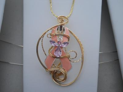 Rose gold wire sculpted pink ribbon.